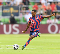 AUSTIN, TX - JULY 29: Kellyn Acosta #23 of the United States takes a shot at the Qatar goal during a game between Qatar and USMNT at Q2 Stadium on July 29, 2021 in Austin, Texas.
