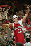 Albuquerque, NW - 3/25/00. University of Wisconsin guard Mike Kelley (22) cuts a piece of the net down after defeating Purdue University  64-60 to win the 2000 West Regional Final to advance to the Final Four. ©David Stluka