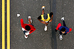 Participants seen from above, run close to the double yellow line on Kelly Drive during the Philadelphia Marathon in Philadelphia, Pennsylvania on November 19, 2006.