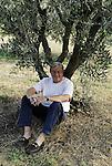 Peter Mayle under an olive tree near Lourmarin.
