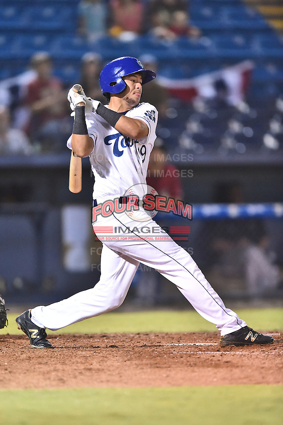 Asheville Tourists right fielder Omar Carrizales (19) swings at a pitch during game one of the Southern Division South Atlantic League Playoffs against the Savannah Sand Gnats on September 9, 2015 in Asheville, North Carolina. The Tourists defeated the Sand Gnats 5-1. (Tony Farlow/Four Seam Images)