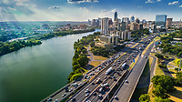 Aerial view of the Austin Skyline as rush hour traffic picks up on I-35 In the heart of Austin is the Ann and Roy Butler Hike-and-Bike Trail at Lady Bird Lake, a lush, urban path that meanders along the water's edge and passes by skyscrapers, neighborhoods, ball fields and cultural attractions.