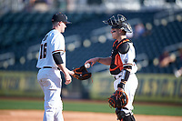 Oregon State Beavers relief pitcher Reid Sebby (16) is greeted by catcher Cole Hamilton (14) as he takes the mound during an NCAA game against the New Mexico Lobos at Surprise Stadium on February 14, 2020 in Surprise, Arizona. (Zachary Lucy / Four Seam Images)