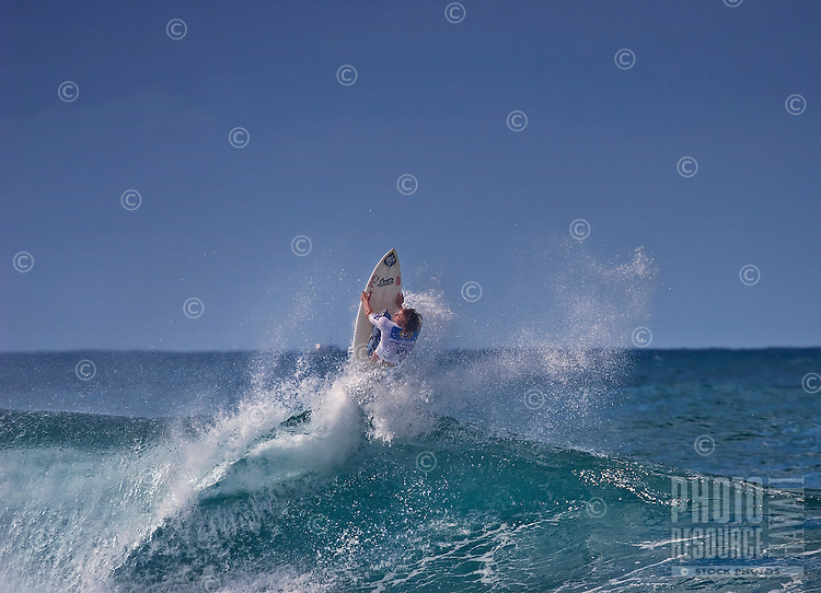 Spectacular surfing maneuver at Rip Curl Pro Pipe Masters 2006, Banzai Pipeline on North Shore of Oahu.