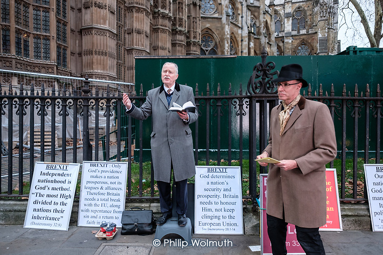 Pro Brexit Christian preacher outside the Houses of Parliament on the day MPs voted decisively to reject Theresa May's withdrawal deal with the EU.  Westminster, London.