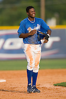 Luis Del Rosario #27 of the Burlington Royals walks off the field after having been called out at second base at Burlington Athletic Park August 4, 2009 in Burlington, North Carolina. (Photo by Brian Westerholt / Four Seam Images)