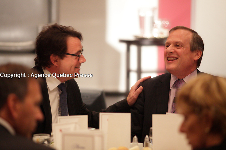 September 26 2012 - Montreal Quebec CANADA - Louis Audet, President & CEO of COGECO et Cogeco Cable,discuss with Pierre-Karl Peladeau, CEO QUEBECOR before speaking at the Canadian Club of Montreal's podium.<br /> <br /> What is Cogeco? A cable distributor? A broadcaster? No one can claim to truly know this major telecommunications industry player better than its President and CEO, Louis Audet. Under his guidance, Cogeco Cable has become the second-largest cable distribution company in QuÈbec and Ontario, serving nearly 900,000 subscribers from GaspÈ to Windsor. Cogeco Cable, through Cogeco Data Services, operates data centres for its business customers in both provinces. Today, Cogeco Diffusion, a COGECO Inc. affiliate company, is a leading Quebec radio broadcaster with 13 stations and provides news services to 47 radio stations across the province. Through Cogeco MÈtromÈdia, the company also offers specialized media representation services in the public transit signage sector in major QuÈbec and Canadian cities. In addition, within a very few months Cogeco Cable will expand its cable distribution operations to the United States following its recent acquisition of Atlantic Broadband.