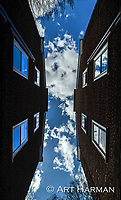 """Skylight"" by Art Harman. A brilliant blue sky with puffy clouds that reflected in the windows offered this unique view."