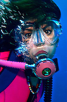 15 August 2005: Scuba diver Sally Herschorn poses for a photo in thirty feet of water at La Machaca Reef off the coast of Bonaire, in the Netherland Antilles. Housing used was an Aquatica D100 with flat port. Lighting with a single Ikelite 225s strobe at 1/4 power setting. Mandatory Photo Credit: Ed Wolfstein Photo