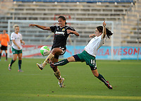 FC Gold Pride midfielder Shannon Boxx (77) plays the ball in front lunging Red Stars forward Karen Carney (14).  The FC Gold Pride defeated the Chicago Red Stars 3-2 at Toyota Park in Bridgeview, IL on August 22, 2010