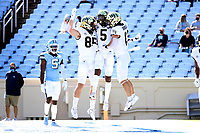 CHAPEL HILL, NC - NOVEMBER 14: Jaquarii Roberson #5 of Wake Forest celebrates his touchdown with teammates Blake Whiteheart #85 and Nolan Groulx #13 during a game between Wake Forest and North Carolina at Kenan Memorial Stadium on November 14, 2020 in Chapel Hill, North Carolina.