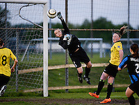 20140502 - VARSENARE , BELGIUM : Brugge's goalkeeper Jana Van Hauwaert (m) pictured saving a Lierse attempt to goal during the soccer match between the women teams of Club Brugge Vrouwen  and WD Lierse SK  , on the 26th matchday of the BeNeleague competition on Friday 2 May 2014 in Varsenare .  PHOTO DAVID CATRY