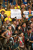 Indigenous people wave banners in protest against PEC 215, a proposal to amend the Brazilian constitution to water down indigenous rights during the International Indigenous Games, in the city of Palmas, Tocantins State, Brazil. Photo © Sue Cunningham, pictures@scphotographic.com 28th October 2015