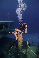 10 June 2014: SCUBA Instructor Ragime Powery sits on a vent stack of the USS Kittiwake, a former United States Navy submarine rescue vessel, off Seven Mile Beach, on the West Shore of Grand Cayman Island. Purchased by the government of the Cayman Islands, the Kittiwake was intentionally sunk on January 5, 2011, to create an artificial reef in the Cayman Marine Park. Located in the British West Indies in the Caribbean, the Cayman Islands are renowned for excellent scuba diving, snorkeling, beaches and banking.  Mandatory Credit: Ed Wolfstein Photo *** RAW (NEF) Image File Available ***
