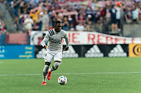 FOXBOROUGH, MA - JULY 25: Zachary Brault-Guillard #15 of CF Montreal brings the ball forward during a game between CF Montreal and New England Revolution at Gillette Stadium on July 25, 2021 in Foxborough, Massachusetts.