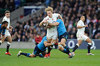 Billy Twelvetrees of England is tackled by Leonardo Ghiraldini and Andrea Masi of Italyduring the RBS 6 Nations match between England and Italy at Twickenham Stadium on Saturday 14th February 2015 (Photo by Rob Munro)