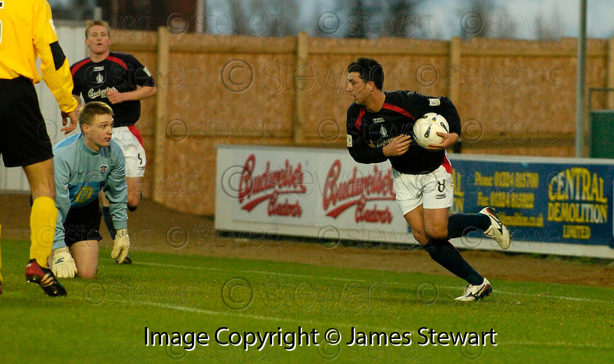 18/12/2004  Copyright Pic : James Stewart.File Name : jspa04_falkirk_v_qots.PEDRO MOUTINHO CELEBRATES AFTER HE SCORES FALKIRK'S FIRST.......Payments to :.James Stewart Photo Agency 19 Carronlea Drive, Falkirk. FK2 8DN      Vat Reg No. 607 6932 25.Office     : +44 (0)1324 570906     .Mobile   : +44 (0)7721 416997.Fax         : +44 (0)1324 570906.E-mail  :  jim@jspa.co.uk.If you require further information then contact Jim Stewart on any of the numbers above.........