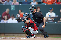 Carolina Mudcats catcher Mario Feliciano (4) misses a pitch as home plate umpire Steven Jaschinski looks on during the game against the Winston-Salem Dash at BB&T Ballpark on June 1, 2019 in Winston-Salem, North Carolina. The Dash defeated the Mudcats 5-4 in game two of a double header. (Brian Westerholt/Four Seam Images)