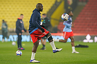 Adebayo Akinfenwa of Wycombe Wanderers warms up ahead of the Sky Bet Championship behind closed doors match between Watford and Wycombe Wanderers at Vicarage Road, Watford, England on 3 March 2021. Photo by David Horn.