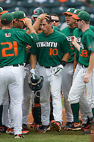 Nathan Melendres #10 of the Miami Hurricanes celebrates after hitting a home run against the Virginia Cavaliers at the 2010 ACC Baseball Tournament at NewBridge Bank Park May 29, 2010, in Greensboro, North Carolina.  The Cavaliers defeated the Hurricanes 12-8.  Photo by Brian Westerholt / Four Seam Images
