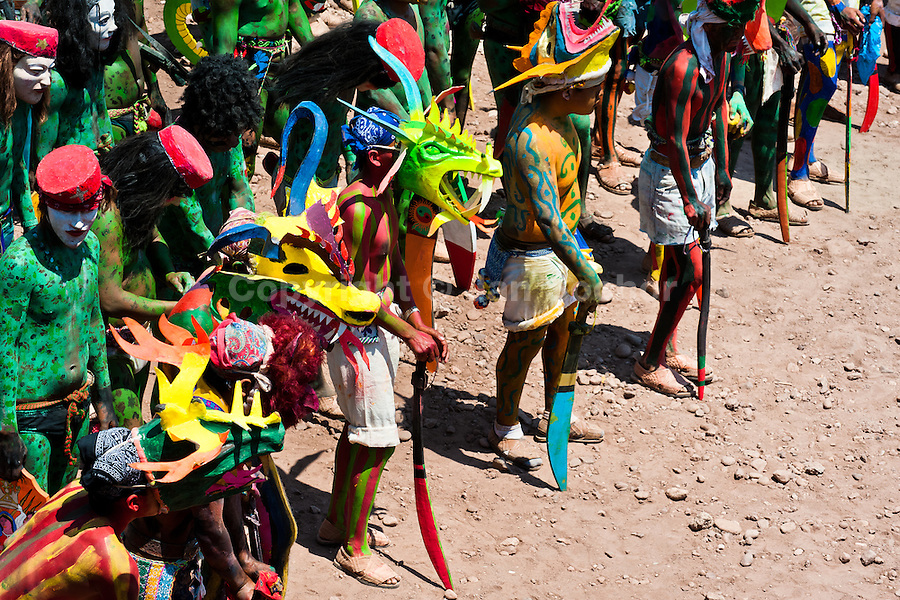 """Cora Indians, wearing colorful demon masks, take a part in a procession during the sacred ritual ceremony of Semana Santa (Holy Week) in Jesús María, Nayarit, Mexico, 22 April 2011. The annual week-long Easter festivity (called """"La Judea""""), performed in the rugged mountain country of Sierra del Nayar, merges indigenous tradition (agricultural cycle and the regeneration of life worshipping) and animistic beliefs with the Christian dogma. Each year in the spring, the Cora villages are taken over by hundreds of wildly running men. Painted all over their semi-naked bodies, fighting ritual battles with wooden swords and dancing crazily, they perform demons (the evil) that metaphorically chase Jesus Christ, kill him, but finally fail due to his resurrection. La Judea, the Holy Week sacred spectacle, represents the most truthful expression of the Coras' culture, religiosity and identity."""