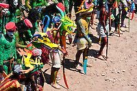 "Cora Indians, wearing colorful demon masks, take a part in a procession during the sacred ritual ceremony of Semana Santa (Holy Week) in Jesús María, Nayarit, Mexico, 22 April 2011. The annual week-long Easter festivity (called ""La Judea""), performed in the rugged mountain country of Sierra del Nayar, merges indigenous tradition (agricultural cycle and the regeneration of life worshipping) and animistic beliefs with the Christian dogma. Each year in the spring, the Cora villages are taken over by hundreds of wildly running men. Painted all over their semi-naked bodies, fighting ritual battles with wooden swords and dancing crazily, they perform demons (the evil) that metaphorically chase Jesus Christ, kill him, but finally fail due to his resurrection. La Judea, the Holy Week sacred spectacle, represents the most truthful expression of the Coras' culture, religiosity and identity."