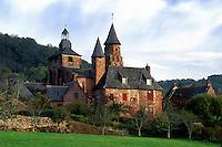 Perigord, Dordogne, Limousin, France, Collonges-la-Rouge, Europe, Scenic view of the medieval village of Collonges-la-Rouge made entirely of bright red sandstone.