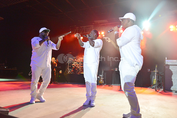POMPANO BEACH, FL - DECEMBER 02: Wanya Morris, Shawn Stockman, and Nathan Morris of Boyz II Men perform onstage at Pompano Beach Amphitheatre on December 2, 2016 in Pompano Beach, Florida. Credit: MPI10 / MediaPunch