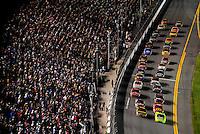 Feb 07, 2009; Daytona Beach, FL, USA; NASCAR Sprint Cup Series drivers head to the green flag during the Bud Shootout at Daytona International Speedway. Mandatory Credit: Mark J. Rebilas-