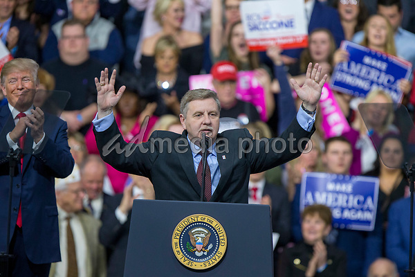 Rick Saccone, Republican Congressional candidate for Pennsylvania's 18th district, speaks to supporters as United States President Donald J. Trump looks on during a Make American Great Rally at Atlantic Aviation in Moon Township, Pennsylvania on March 10th, 2018. Photo Credit: Alex Edelman/CNP/AdMedia