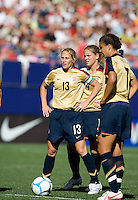 Kristine Lilly stands over a free kick with Cat Whitehill and Shannon Boxx. USA defeated Brazil 2-0 at Giants Stadium on Sunday, June 23, 2007.