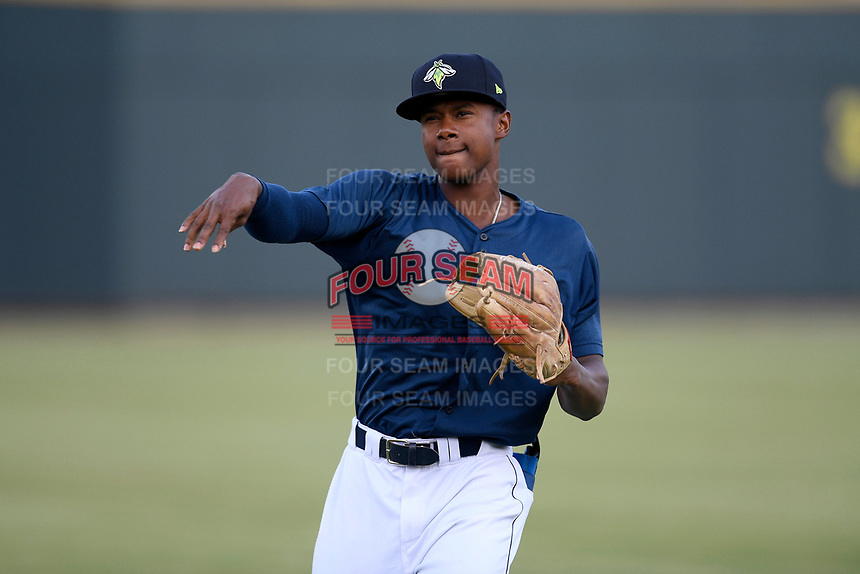 Center fielder Hansel Moreno (48) of the Columbia Fireflies warms up before a game against the Rome Braves on Tuesday, June 4, 2019, at Segra Park in Columbia, South Carolina. Columbia won, 3-2. (Tom Priddy/Four Seam Images)