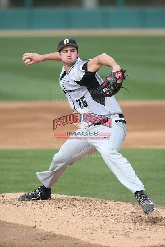 Connor Fannon (26) of the Oakland Grizzlies pitches during a game against the Southern California Trojans at Dedeaux Field on February 21, 2015 in Los Angeles, California. Southern California defeated Oakland, 11-1. (Larry Goren/Four Seam Images)