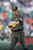 Vanderbilt Commodores pitcher Carson Fulmer (15) before the NCAA College baseball World Series against the Cal State Fullerton Titans on June 14, 2015 at TD Ameritrade Park in Omaha, Nebraska. The Titans were leading 3-0 in the bottom of the sixth inning when the game was suspended by rain. (Andrew Woolley/Four Seam Images)