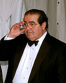 Washington, D.C. - April 29, 2006 -- Associate Justice Antonin Scalia adjusts his glasses as he departs the Embassy of the Republic of Macedonia in Washington, D.C. following the Bloomberg News party following the annual White House Correspondents Association (WHCA) dinner.<br /> Credit: Ron Sachs / CNP<br /> <br /> (RESTRICTION: NO New York or New Jersey Newspapers or newspapers within a 75 mile radius of any part of New York, New York, including without limitation the New York Daily News, The New York Times, and Newsday.)