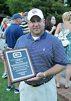 Rome Braves general manager Mike Dunn holds his Hall of Fame plaque at the 2010 South Atlantic League All-Star Game welcome party and festivities Monday night June 21, 2010, at the Wyche Pavilion along the Reedy River in Greenville, S.C. Photo by: Tom Priddy/Four Seam Images