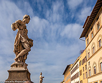 Italy, Florence statues along the right bank of Arno river