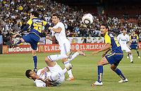 Trevino Patricio (33, left) Migual Layun (bottom, center) Cristiano Ronaldo (center) and Antonio Lopez (right) watch the ball go out of play. Real Madrid defeated Club America 3-2 at Candlestick Park in San Francisco, California on August 4th, 2010.