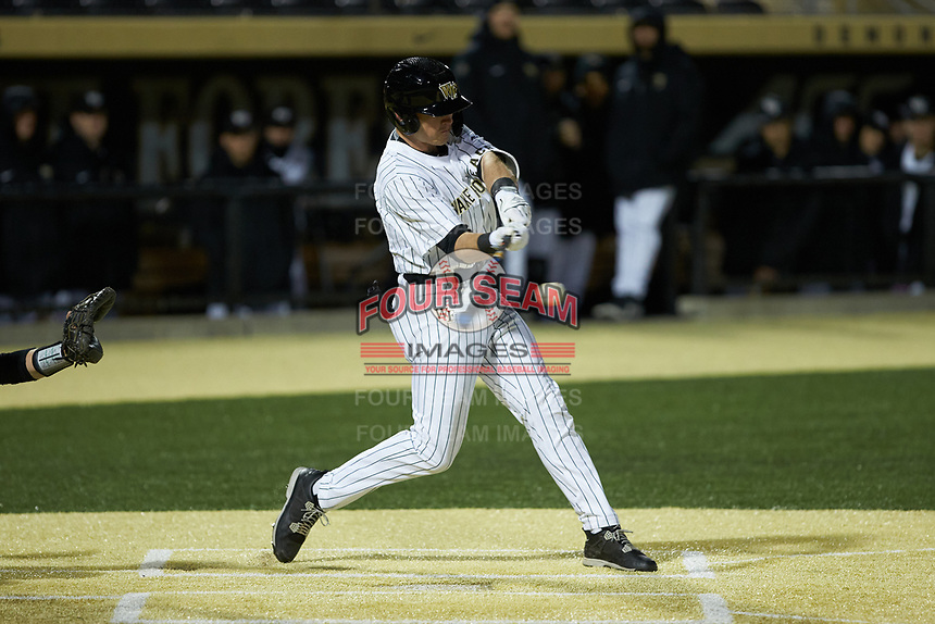 Chris Lanzilli (24) of the Wake Forest Demon Deacons makes contact with the baseball during the game against the Louisville Cardinals at David F. Couch Ballpark on March 6, 2020 in  Winston-Salem, North Carolina. The Cardinals defeated the Demon Deacons 4-1. (Brian Westerholt/Four Seam Images)