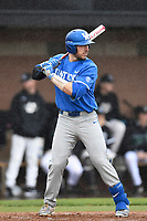 Catcher Kole Cottam (13) of the Kentucky Wildcats bats in a game in the rain against the University of South Carolina Upstate Spartans on Saturday, February 17, 2018, at Cleveland S. Harley Park in Spartanburg, South Carolina. Kentucky won, 6-5, in 10 innings. (Tom Priddy/Four Seam Images)