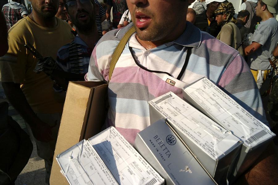 Looting guns from the Bab Al Aziziya compound in Tripoli, Libya