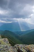 Storm (rain) clouds engulf Owls Head Mountain from the summit of Bondlcliff Mountain in the Pemigewasset Wilderness of New Hampshire during the summer months. Hellgate Ravine is in the foreground.