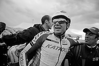 a happy race winner: Alexander Kristoff (NOR/Katusha) rides straight into the arms af a soigneur straight after finishing and awaits his teammates to celebrate<br /> <br /> 2014 Milano - San Remo