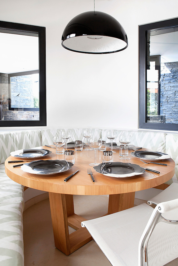 """Contemporary dining area<br /> <br /> A residence in Athens, Greece designed by famed architect, Javier Barba.  The home is designed on the basis of """"green architecture"""" integrating renewable resources and natural elements in it's design."""