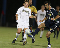 Matt Armstrong #15 of the University of Notre Dame moves in on Justin Meram #9 of the University of Michigan during a men's NCAA match at the new Alumni Stadium on September 1 2009 in South Bend, Indiana. Notre Dame won 5-0.