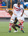 "Stirling's Craig Wedderburn holds off Alloa""s Greig Spence."