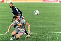 FOXBOROUGH, MA - AUGUST 29: Tim Parker #26 of New York Red Bulls heads the ball clear during a game between New York Red Bulls and New England Revolution at Gillette Stadium on August 29, 2020 in Foxborough, Massachusetts.