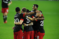 WASHINGTON, DC - OCTOBER 28: Julian Gressel #31 of D.C. United celebrates his score with teammates during a game between Columbus Crew and D.C. United at Audi Field on October 28, 2020 in Washington, DC.