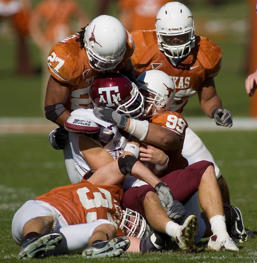 24 November 2006: Texas A&M quarterback (#7) is tackled by a host of Longhorn defenders during the Aggies 12-7 victory over the University of Texas Longhorns at Darrell K Royal Memorial Field in Austin, TX.