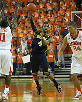 Nov 30, 2010; Clemson, SC, USA; Michigan Wolverines guard Darius Morris (4) passes the ball past Clemson Tigers guard Andre Young (11) in the game against the Clemson Tigers at Littlejohn Coliseum. Mandatory Credit: Daniel Shirey/WM Photo -US PRESSWIRE